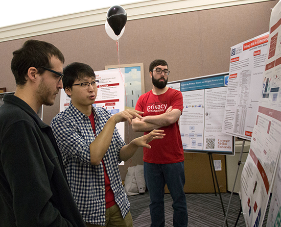 Student explaining research poster at Data Privacy Day